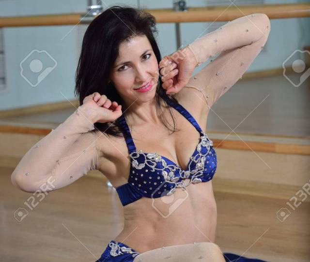 Stock Photo Young Beautiful Sexy Belly Dancer In Arabic Costume Dancing On A Floor