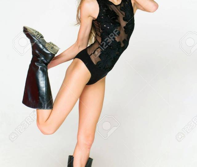 Stock Photo Young Pretty Woman Or Cute Sexy Girl With Long Wet Hair And Flexible Body In Fashionable Black Lace Bodysuit And Dirty Boots Poses On White