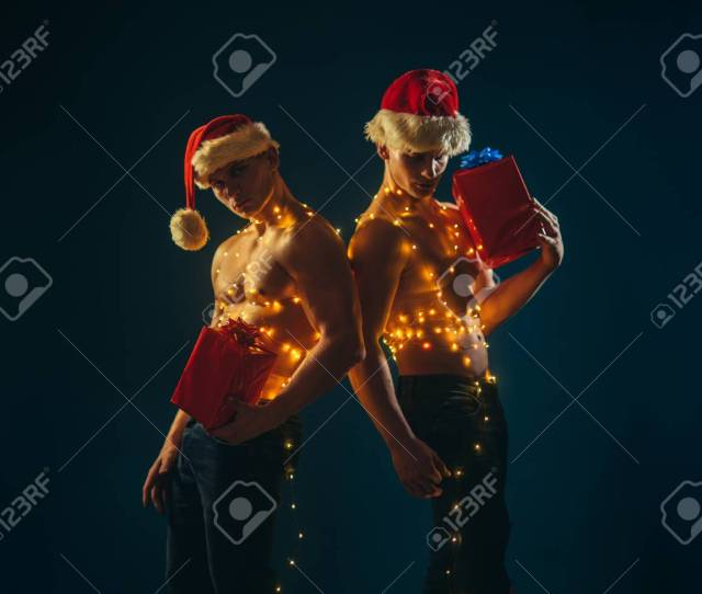 Christmas Party And Sex Games Young Men In Santa Costume Present For Girls Call Boys Or Sexy Athlete Men At Xmas