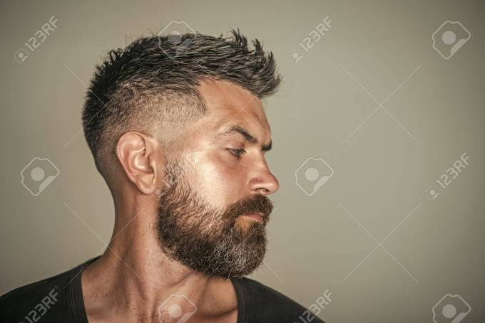 barber shop. hair style. man with bearded face profile and stylish..