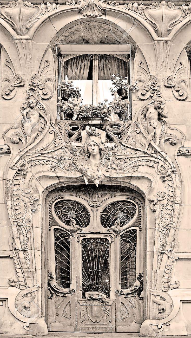 typical art nouveau building in paris france sepia
