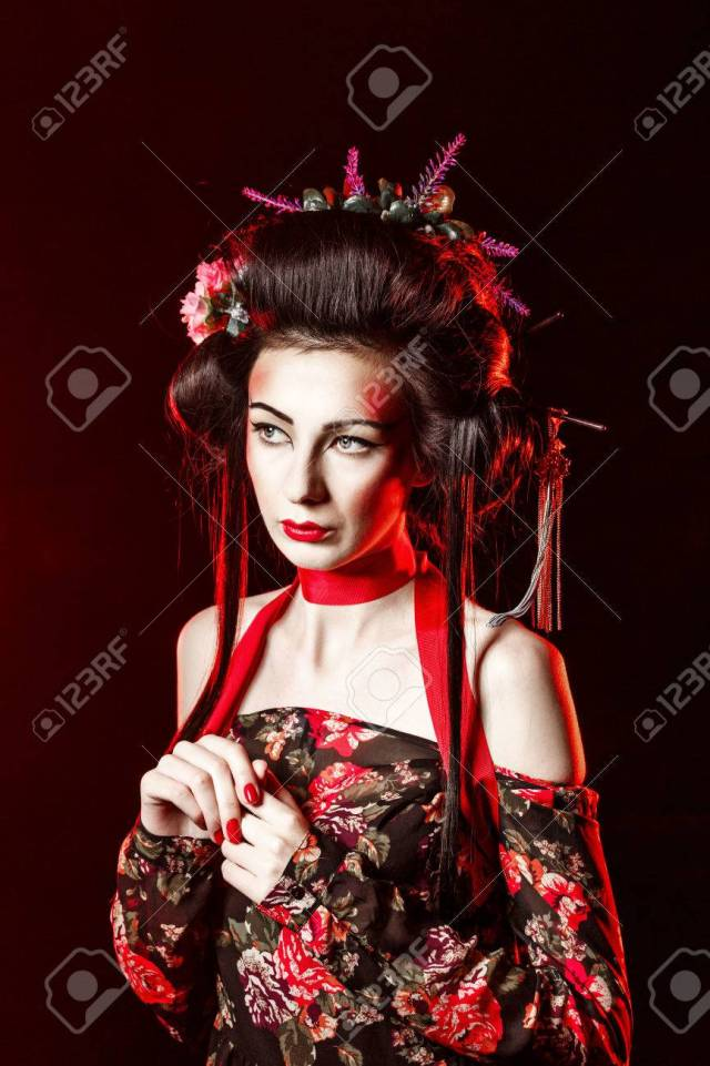 portrait of an attractive geisha with bright makeup and hairstyles..