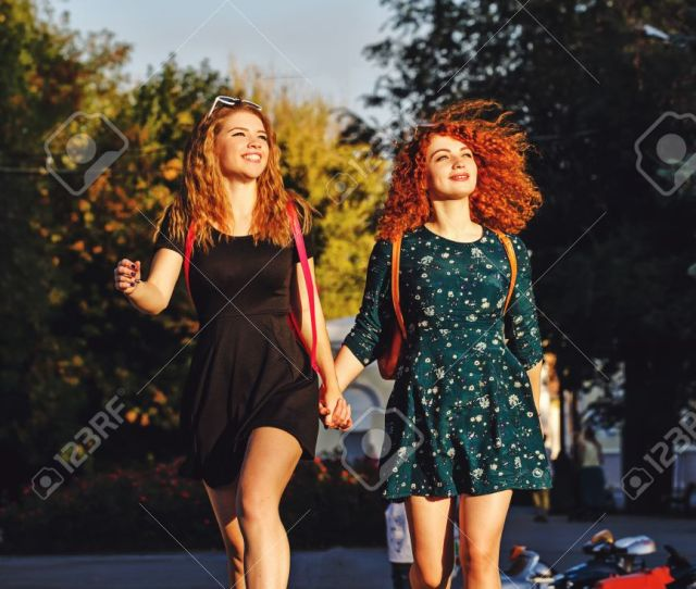 Best Friends Female Students In A City Park Girl Walking Barefoot In The Park