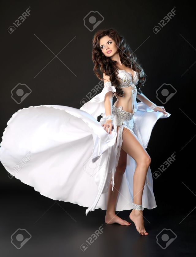 Bellydance Beautiful Arabic Sexy Belly Dancer In Blowing White Dress Dancing Isolated On Black Studio