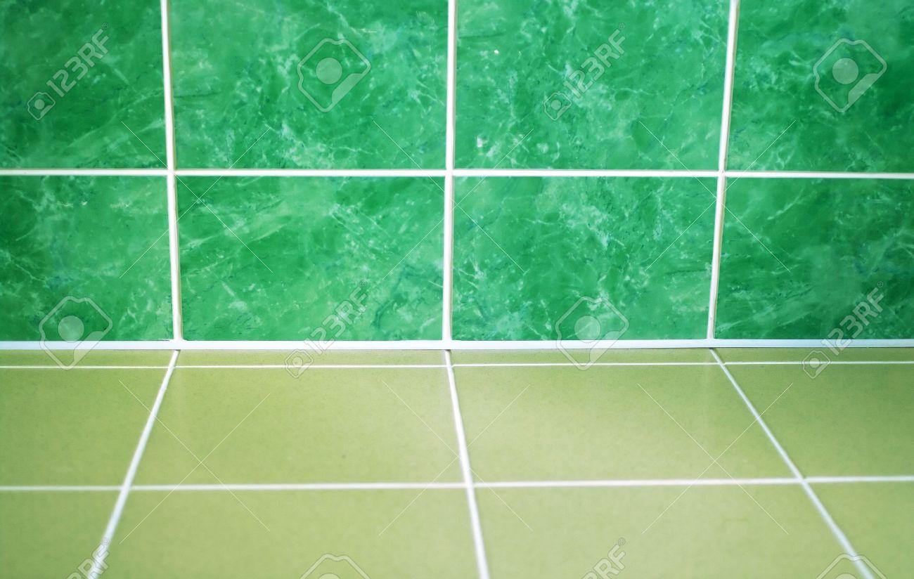 ceramic tile floor of green color shallow dof