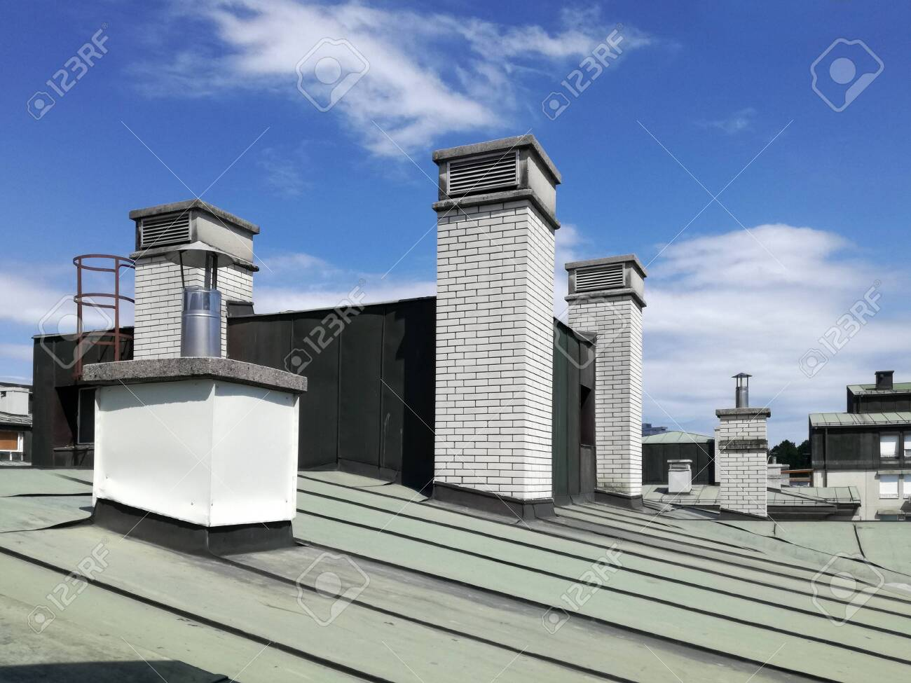 chimneys and vents on the tin roof of the building a chimney stock photo picture and royalty free image image 132191096
