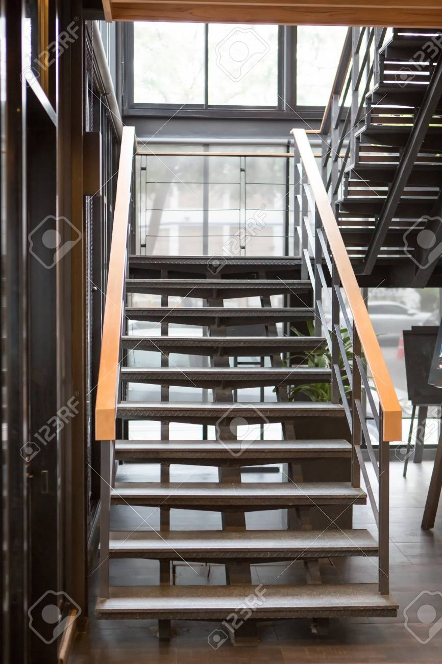 Indoor Concrete Staircase With Wood Handrail Stock Photo Picture | Handrail For Stairs Indoor | Short Staircase | Victorian | Width Hand | Wall | Glass Panel Stainless Steel Handrail