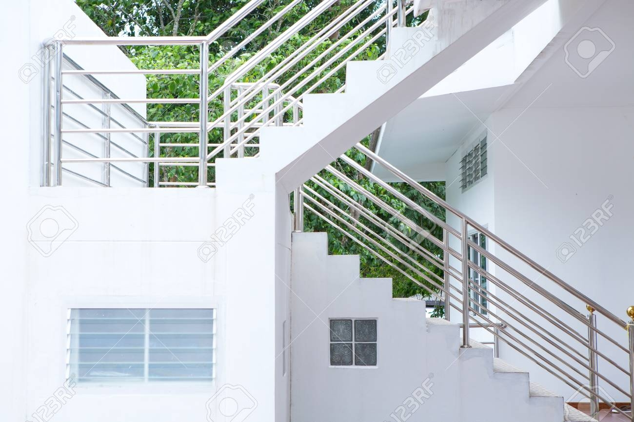 Concrete Staircase With Stainless Steel Handrail In The Building | Building A Handrail For Concrete Stairs | Deck Railing | Deck | Steel Handrail | Porch | Outdoor Stair