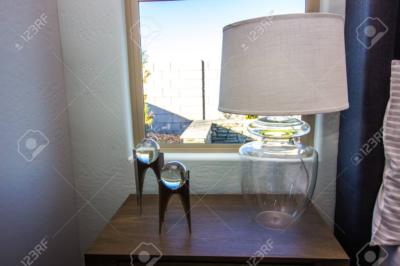Bedroom Glass Lamp With Shade On Wooden Nightstand
