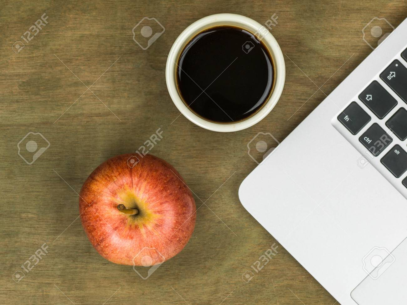 https www 123rf com photo 82666248 computer workstation with an apple and a cup of black coffee on a distressed wooden desk top html