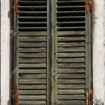Old Window Shutters With Fading Green Paint