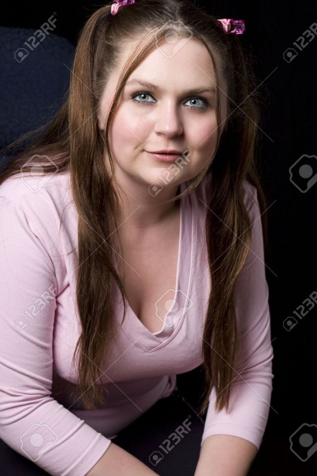 Chubby Girl In Pink Shirt Smiling Stock Photo 4946058