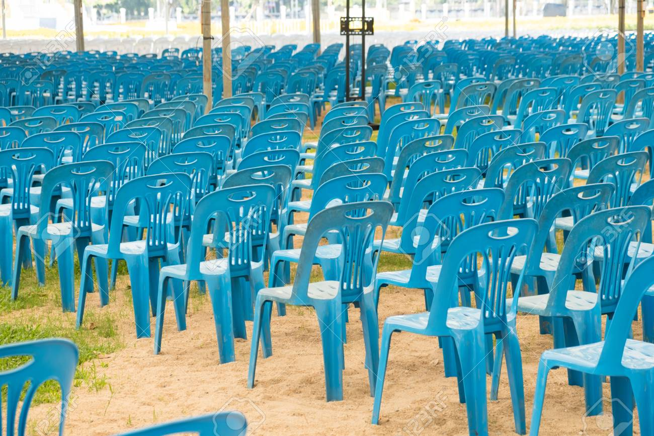 Stack Of Blue Plastic Chairs