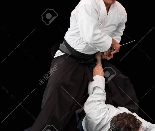 Aikido Master Disarms His Opponent During A Public Fight Demonstration Stock Photo
