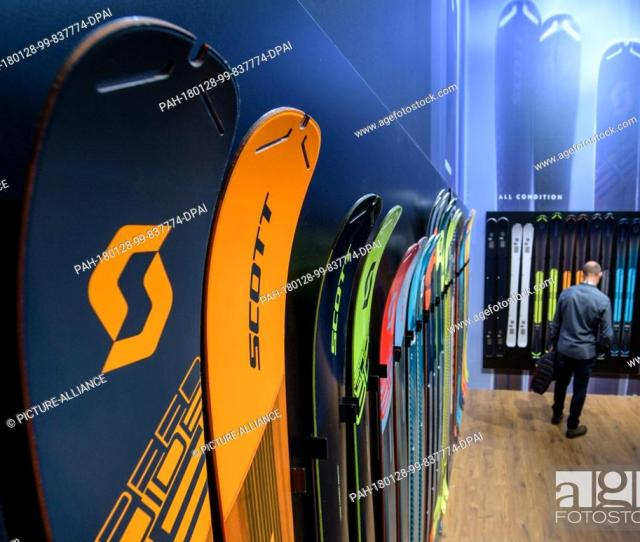 Stock Photo A Visitor Looks At Skis At The Scott Stall At The Ispo Sporting Goods Trade Fair In Munich Germany