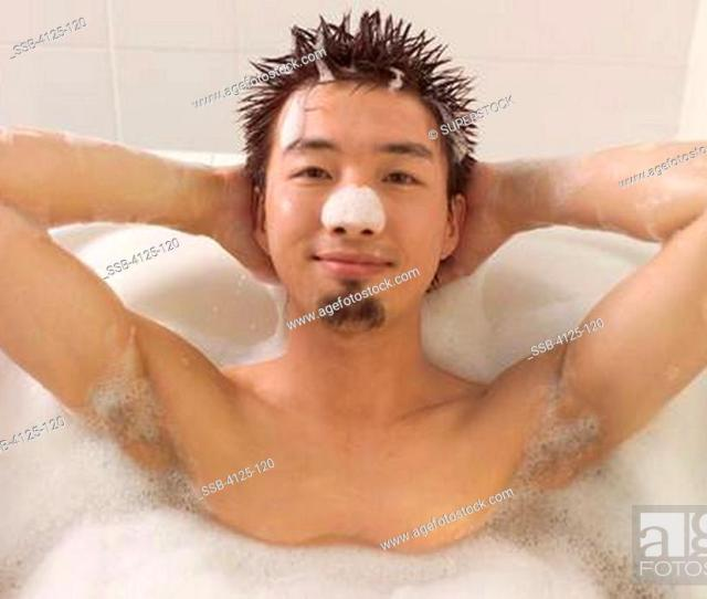 Stock Photo Asian Man Relaxing In Bath Before Massage At Spa Usa