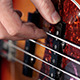 Bass Player Playing With Strings