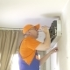 Service Man To Clean Air Conditioner