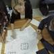 a Group Of Electricians, Each Blueprint Discusses