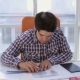 Young Architect, Businessman In Modern Bright Clean Office Working With Blueprint And Plans.