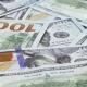 Many 100 US Dollars Bank Notes Rotating Business Background