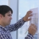 Architects Works With Sketch, Drawing, Plan Near Bright Clean Office Panoramic Window.