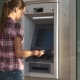 Woman Inserts Banking Card In ATM
