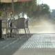 Man Washing Sidewalk In The Morning