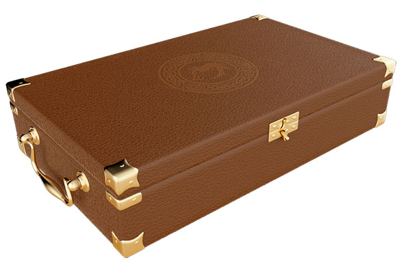 A small leather suitcase with a decorative stamp in the texture of the cover.