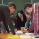 Group of Students Together with Teacher Are Working on a Startup Project