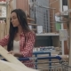 Young Girl Shopping in Hardware Store