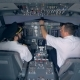 Two Pilots Are Sitting in an Airplane Cabin and Discussing Something