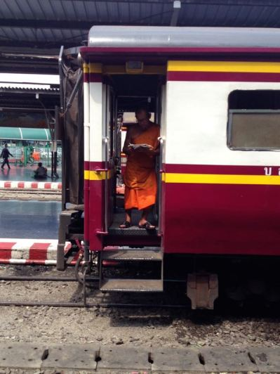 monk on the train in Bangkok