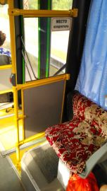 the seat for the bus conductor :)