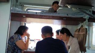 Kazakh family having tea on the train
