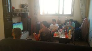back in bishkek there is a fifa party in the living room