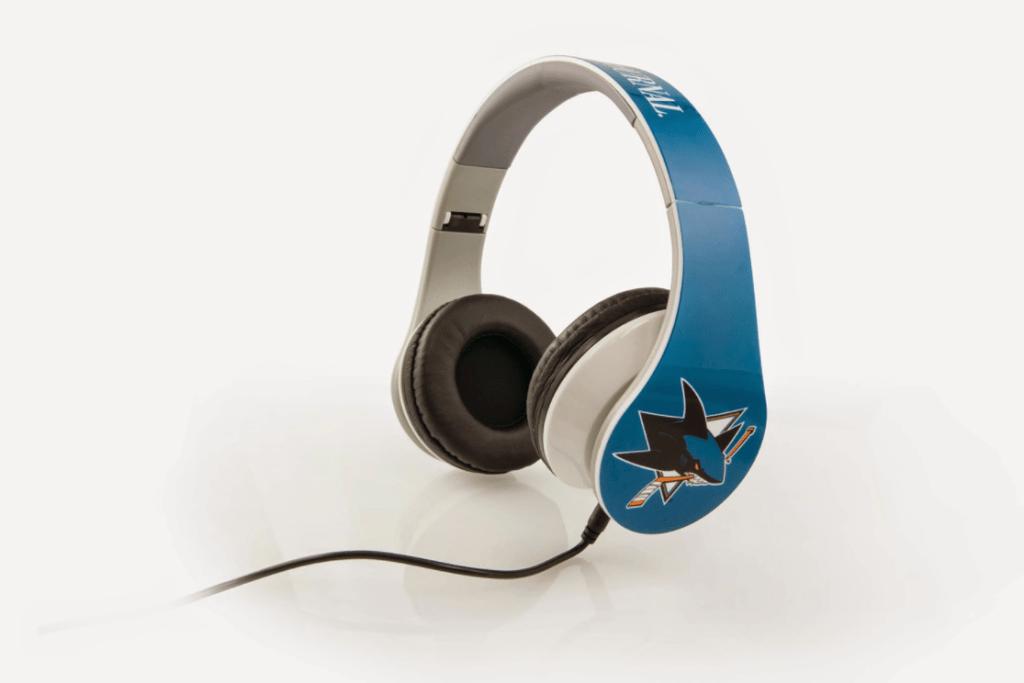 Custom headphones with an all over print of teal and an image of the San Jose Sharks hockey team logo on each ear.