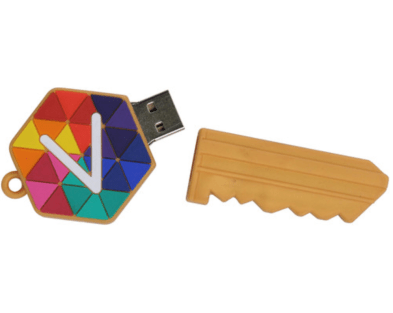 A computer USB flash storage drive in the custom shape of a house key that pulls art to reveal the USB end.