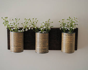 Vintage tin cans are decorations for your wall on a budget