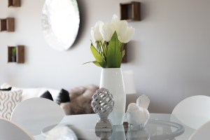 Flowers in a vase are important for home staging.