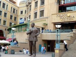 People sitting at Nelson Mandela Square.