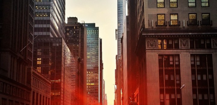 a sunset between buildings in Manhattan