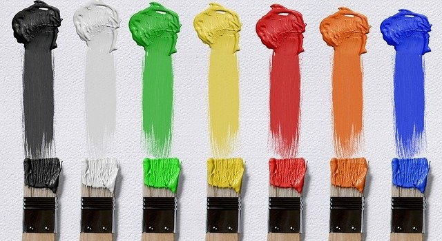 Brushes and paint in various colors.