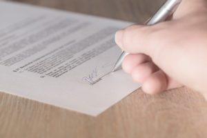 Signing the signature.