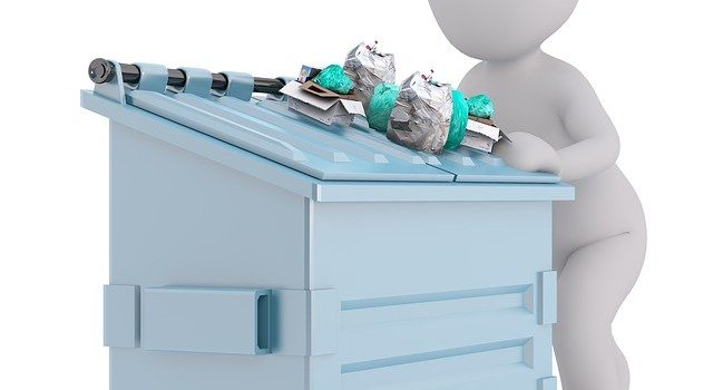 A white figure disposing junk safely, which is the reason for hiring junk removal services.