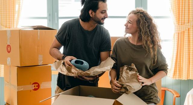 Man and woman packing for moving and talking about moving your expensive antiques.