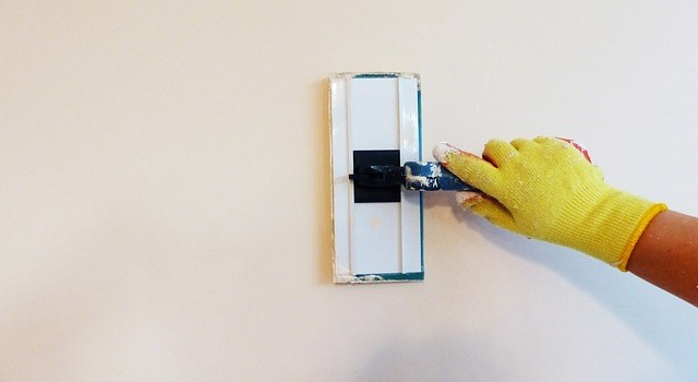 Painting a wall.