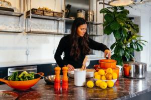 Woman in the kitchen thinking about how to remodel your Seabrook home easily and on a budget.