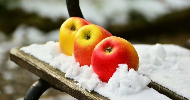 Apples on snow.