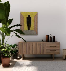 A wooden nordic-style cabinet next to a large bird of paradise house plant